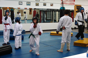 Kids learn sparring for tournaments competition